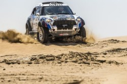 Vasilyev leading the Abu Dhabi Desert Challenge in the MINI ALL4 Turbo Racing at halftime